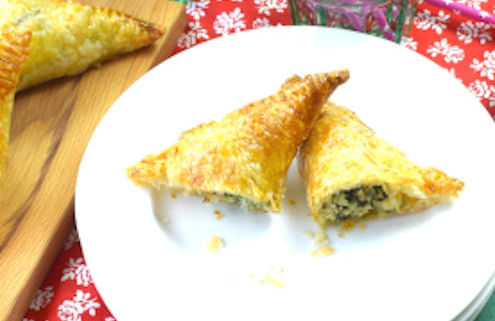 puff pastry triangles stuffed with fish and spinach